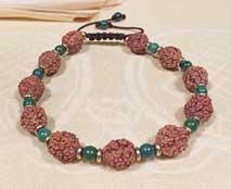 Armband Rudraksha - Türkis Perlen - Goldspacer - Shivas Träne